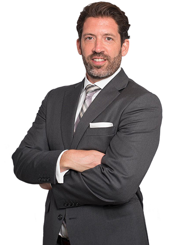 Dr. Cangello in a grey suit