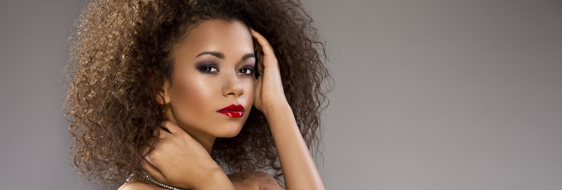 Beautiful woman with curly hair and red lipstick